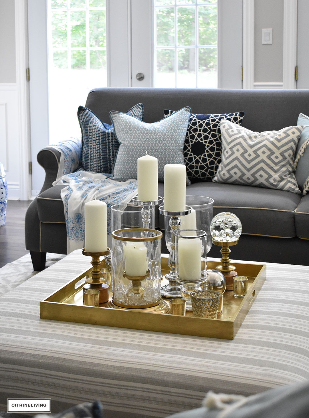 Make a visual statement with a clustered grouping of metal and glass candleholders in varying heights on your coffee table.