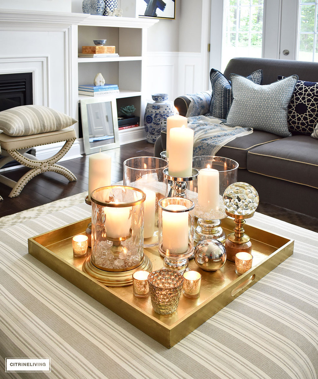 Make a visual statement with a clustered grouping of metal and glass  candleholders in varying heights