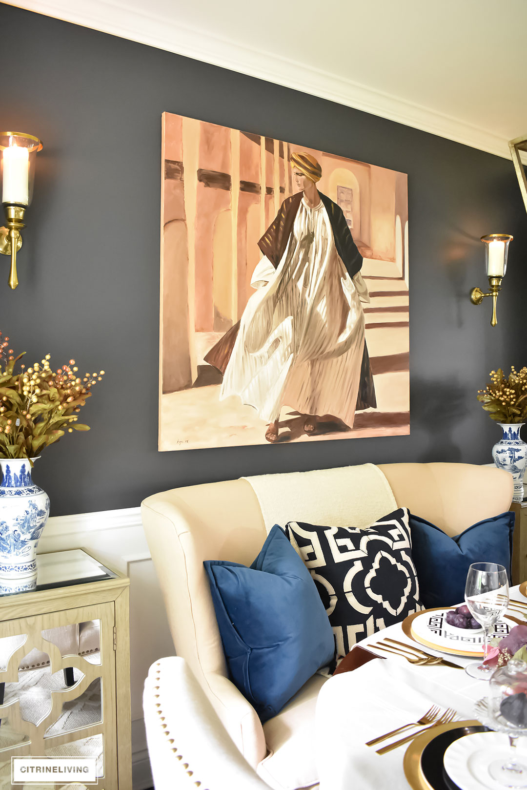 Fall Home Tour. Dining room with original art, settee and wall sconces.