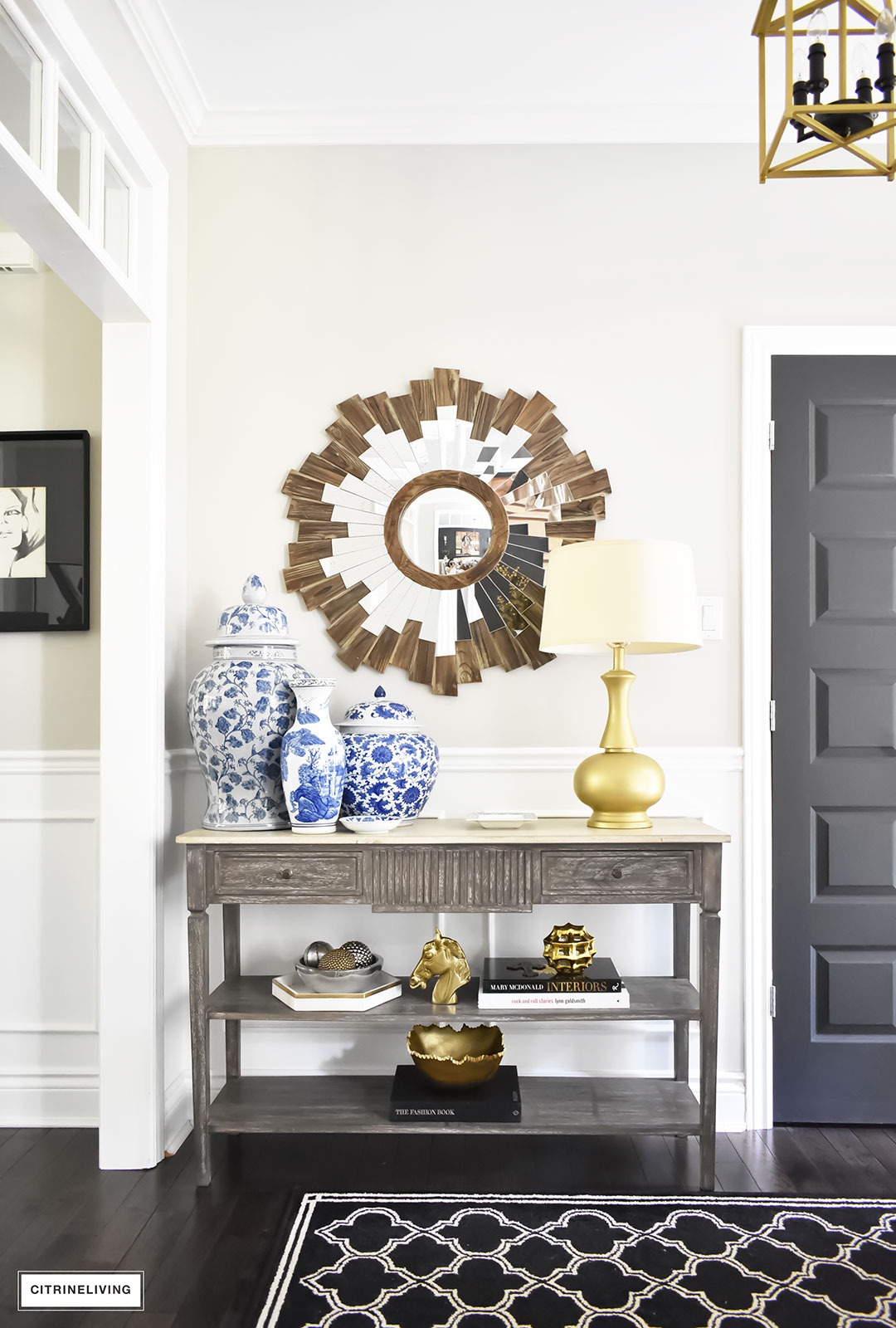 Fall home tour with elegant entryway featuring layers of gold accessories and blue and white ginger jars.