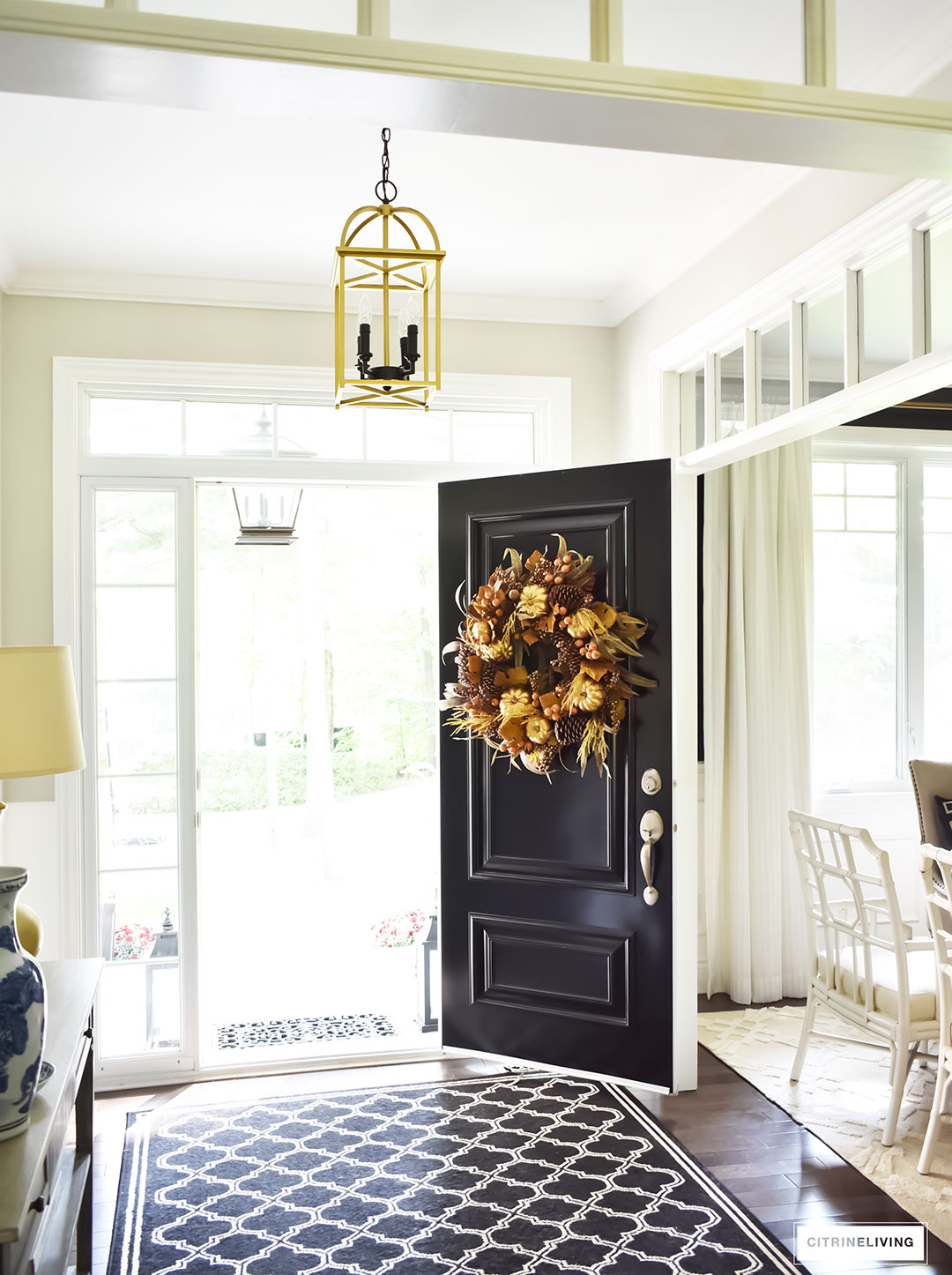 Fall decorating. An elegant entry way featuring a traditional black front door with a rich and sophisticated Fall wreath.