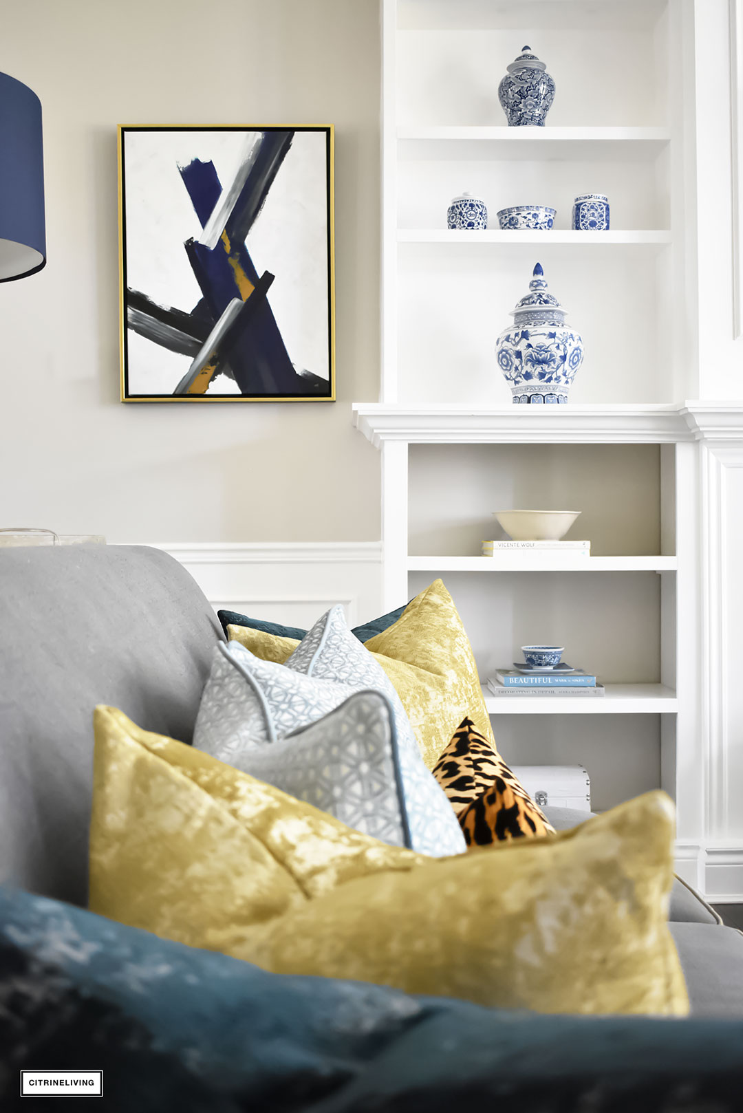Fall Home Tour with navy and gold velvet pillows and accents. Brass lighting and leopard pillow. Blue and white ginger jars. Modern art.