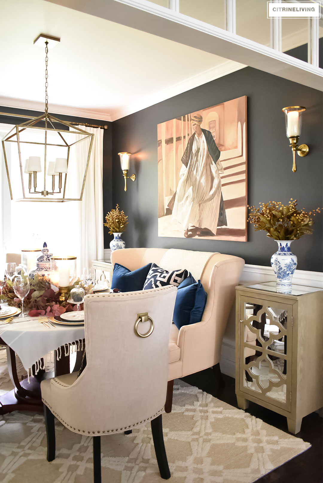 Fall Home Tour. Black dining room with brass lighting and wall sconces. Blue and white chinoiserie.