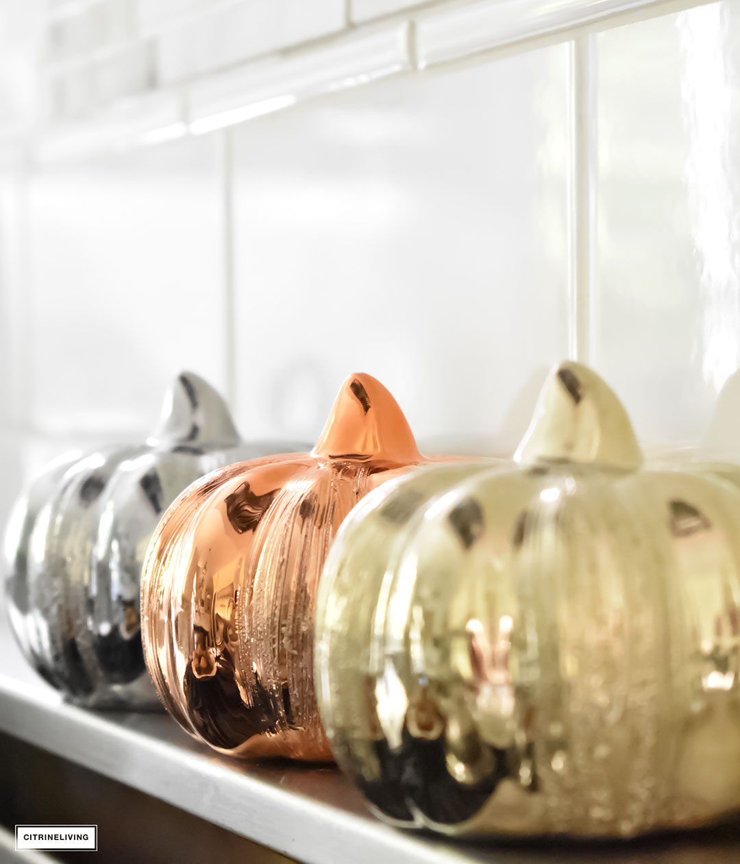 Fall Home Tour - kitchen with mercury glass pumpkins.