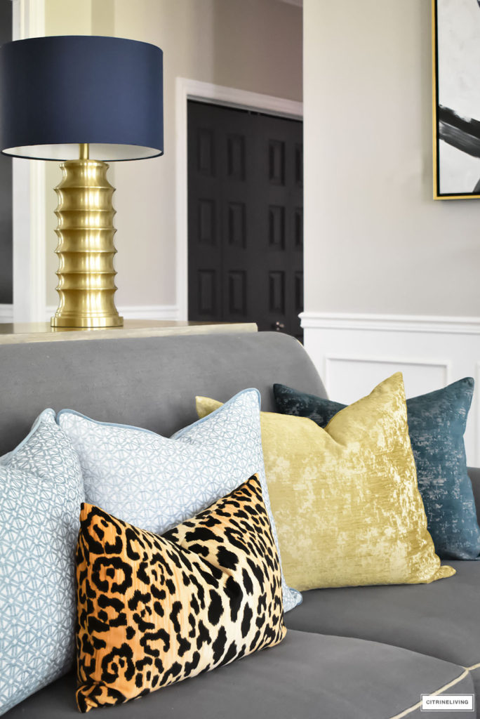 Fall Home Tour with navy and gold velvet pillows and accents. Brass lighting and leopard pillow.