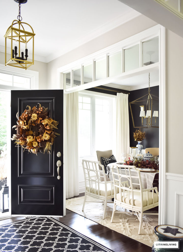 Fall Home Tour entryway with traditional black front door, Fall wreath. Dining room with elegant white lattice-back chairs.