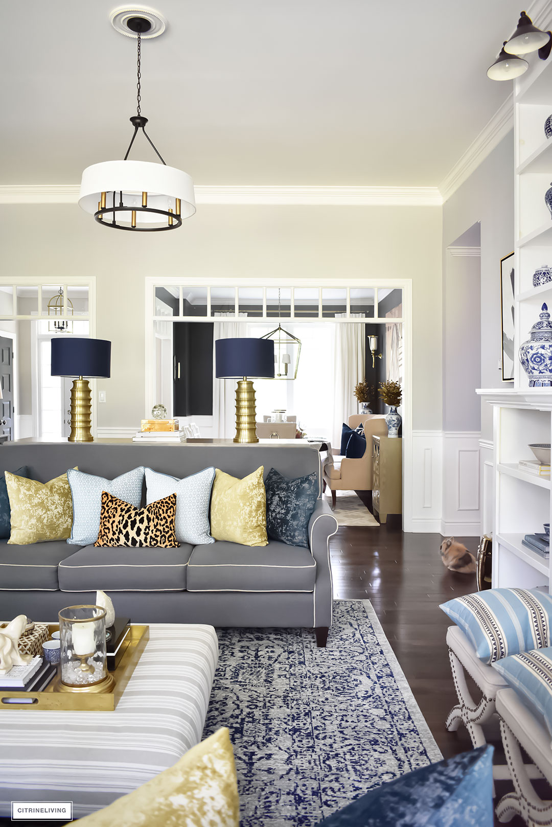 Fall Home Tour with navy and gold velvet pillows and accents. Brass lighting, leopard pillow, drum shade chandelier.