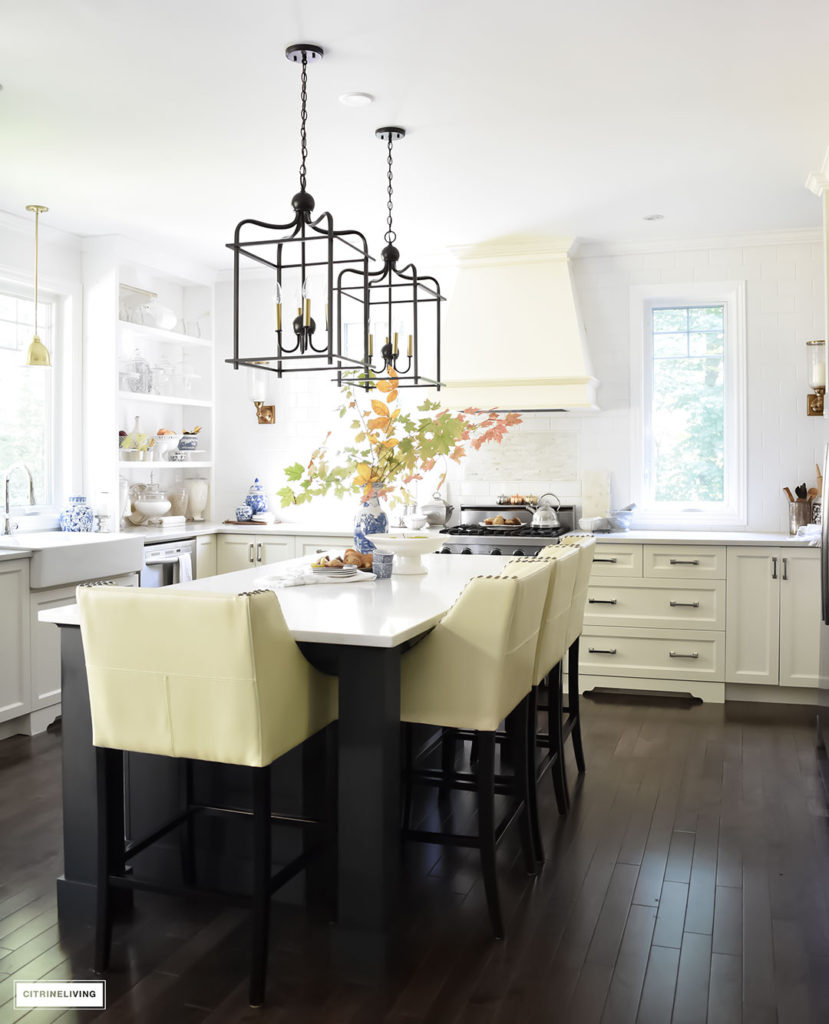 Fall Home Tour - casual elegant black and white kitchen with large black island and lantern style pendant lighting.
