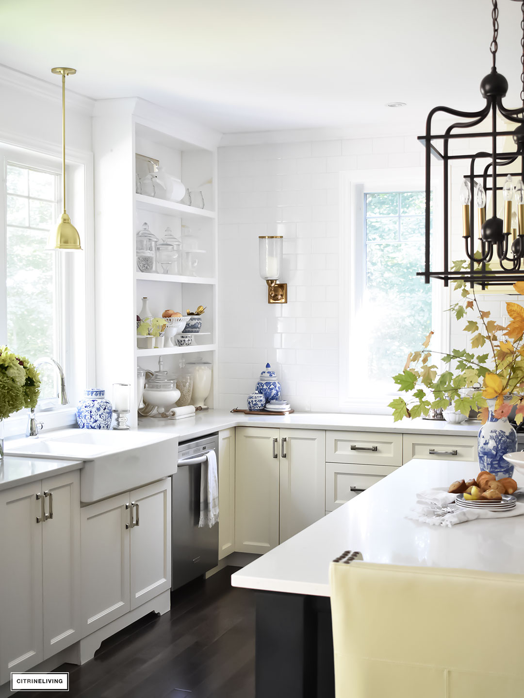 Fall Home Tour - casual elegant black and white kitchen with built-in shelving. Blue and white dishes and fall foliage.