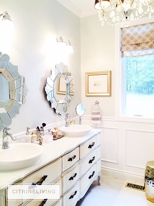 Our master bath makeover is almost finished! Gorgeous details - wall panelling, brass lighting + fixtures, custom window treatment and so much more!