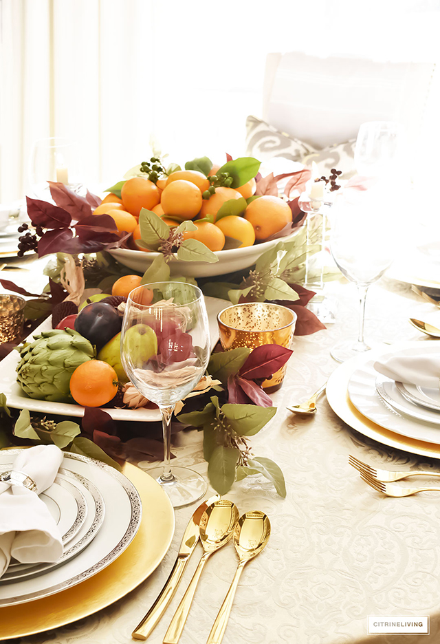 Gorgeous, elegant and bountiful thanksgiving tablescape layered with rich colors and textures from Autumn's beautiful bounty.