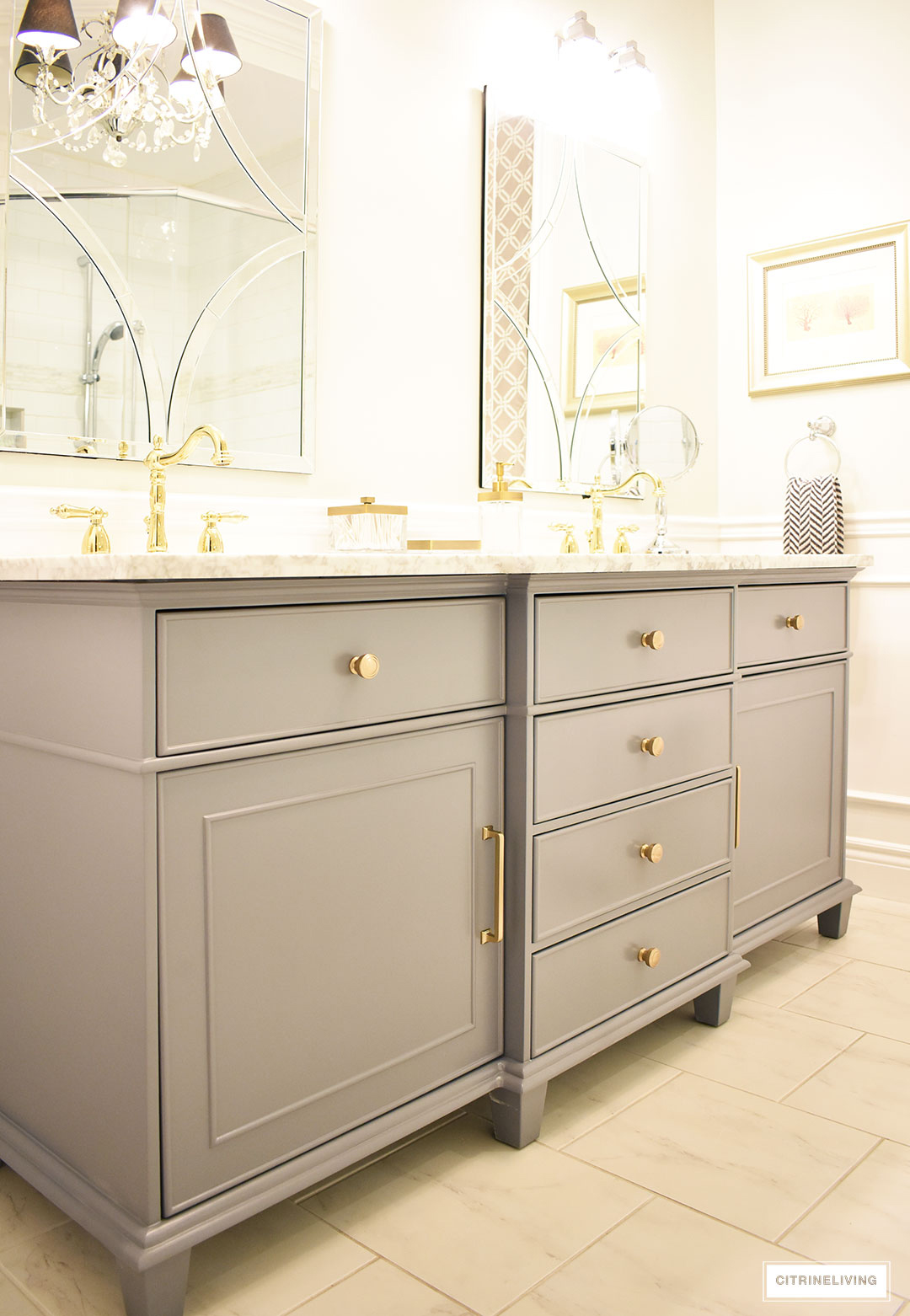 Gorgeous gray vanity with beautiful brass hardware and faucets - our master bathroom makeover is underway!