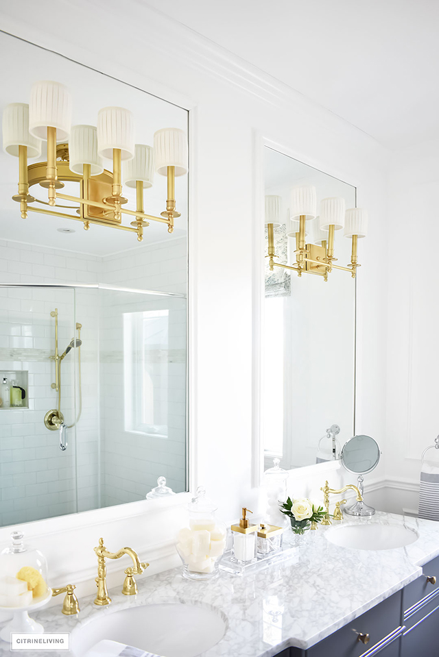 Gorgeous traditional meets modern master bathroom reveal with an elegant color palette of grey, white and brass, accented with blue and white chinoiserie.