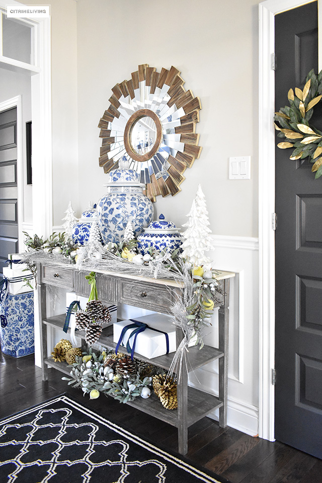 Beautiful Christmas home tour featuring the dining room and entryway dressed in blue, white, green and gold for the perfect holiday mix.