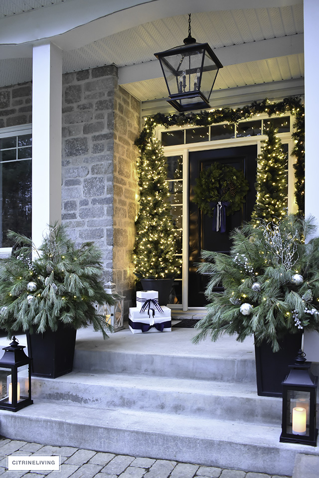 Set a magical scene and welcome your guests on your Christmas front porch this year with fresh greenery and the twinkle of white lights.