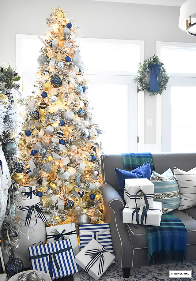 Flocked christmas tree with navy light blue silver and for Blue gold and white christmas tree