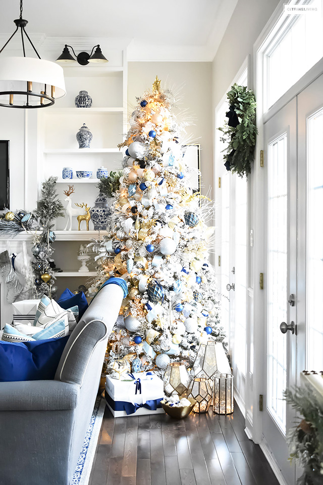 Flocked Christmas Tree With Navy Light Blue Silver And Gold Ornaments