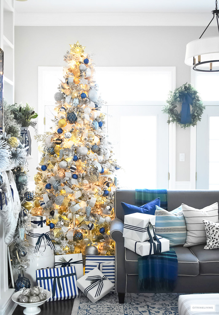 beautiful flocked christmas tree adorned with navy light blue and elegant metallics is - Decorating With Silver And Gold For Christmas