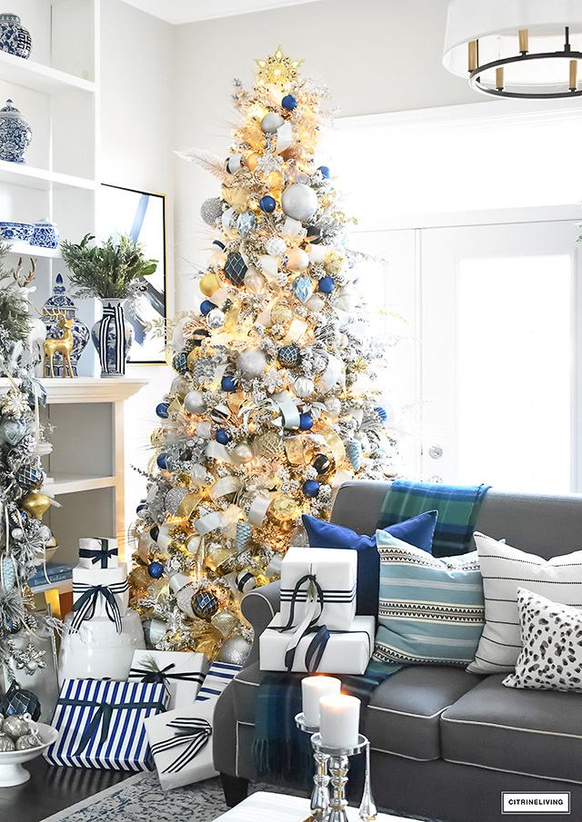 beautiful flocked christmas tree adorned with navy light blue and elegant metallics is