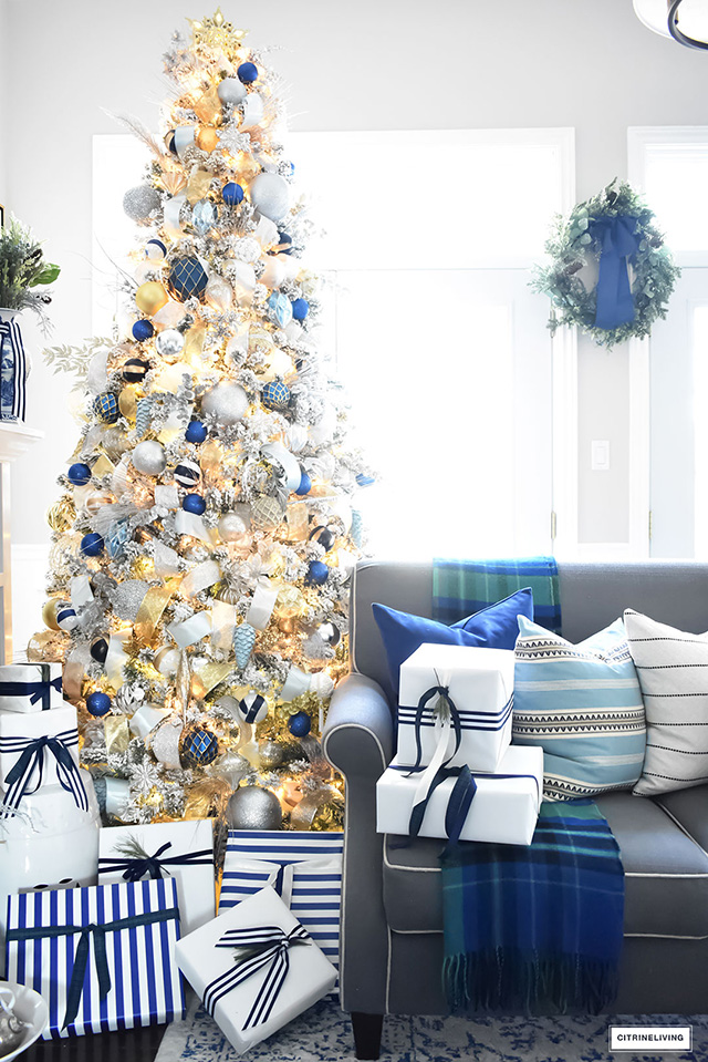 beautiful flocked christmas tree adorned with navy light blue and elegant metallics is navy gold silver