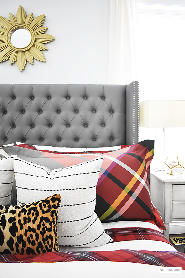 Gorgeous red and white tartan bedding from Williams-Sonoma paired with leopard and stripes is festive and cozy for the holidays and winter season.