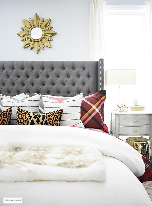 tartan-bedding-fau-fur-blanket-grey-upholstered-headboard-sunburst-mirror