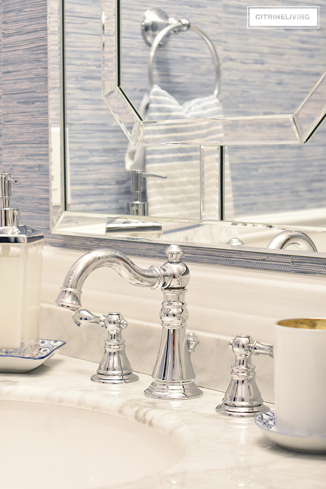 Our kids' bathroom gets a chic, coastal update with a classic white vanity and marble countertop for an elegant and traditional look.