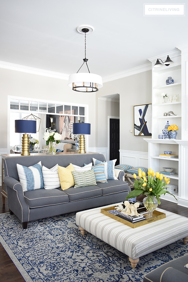 white and blue living room home tour with vibrant yellows and pretty blues 19488