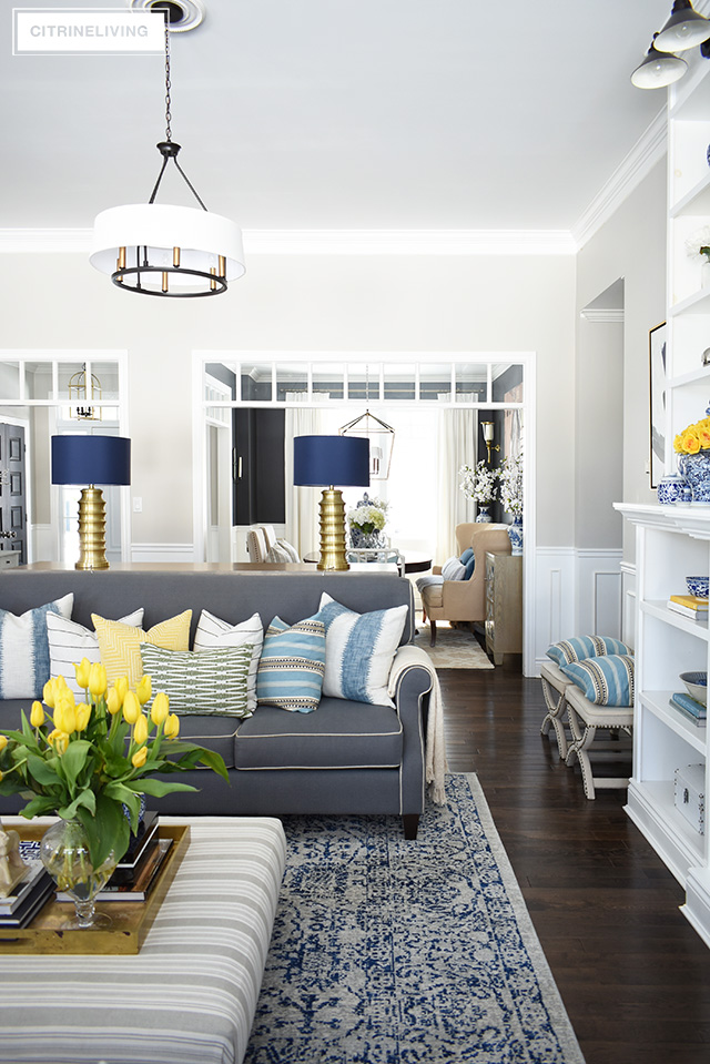 Elegant spring decorating using pretty blue and vibrant yellow accents along with real and faux florals