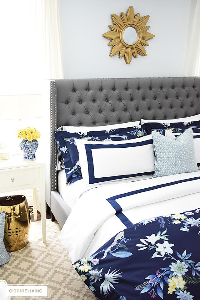 Classic white + navy hotel chic bedding is so gorgeous paired with this navy chinoiserie duvet and shams for a rich and elegant look in our bedroom.