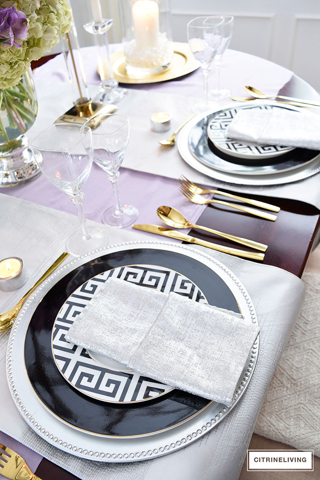 Black and white greek key plates paired with gold, silver and lavender is a stunning combination for any table!
