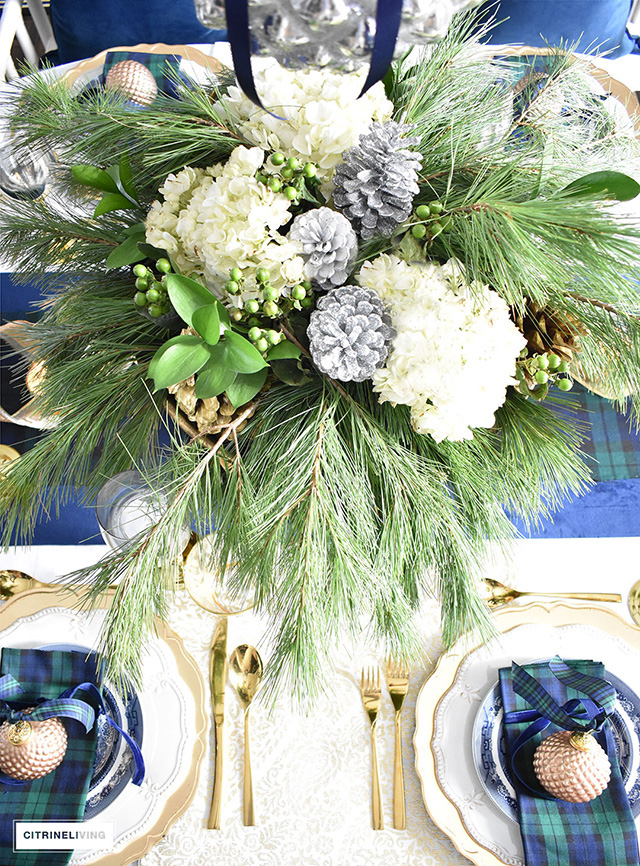 Classic blackwatch tartan in navy and green accented with gold create a stunning tablescape.