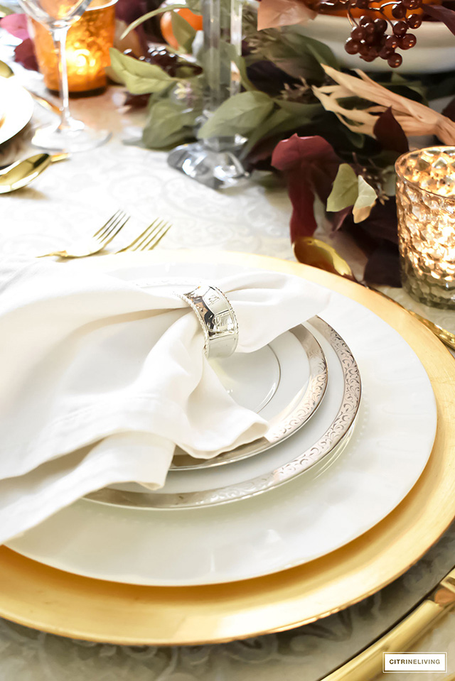 Create a rich and lux tablescape with warm colors paired with gold tones! Soften the look with silver trimmed china and napkins rings!