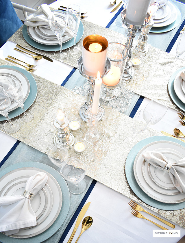 Silver and crystal candleholders with clear beads create an icy-cool look on your tablescape. Gold sequin runners glam up the chic factor!