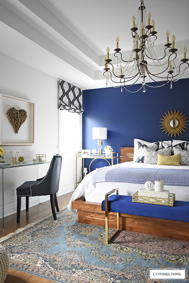 This gorgeous bedroom makeover went from dark and drab to bright and sophisticated with a boho-glam edge that will make you want to create this look yourself!