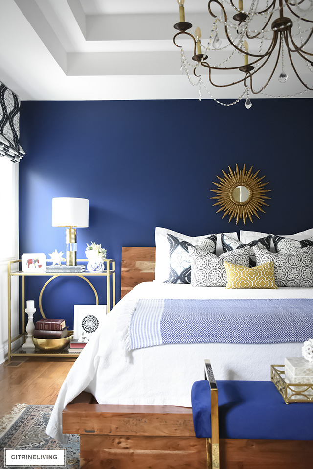 Gorgeous Boho-Glam bedroom with brass, navy blue, and natural elements is the perfect blend of old and new.