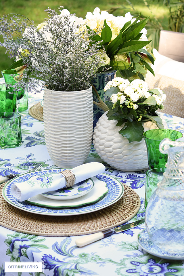 Gorgeous blue, white, and green elegant summer tablescape with a laid back look that's sophisticated and chic! See how to pull this look together for your summer entertaining.