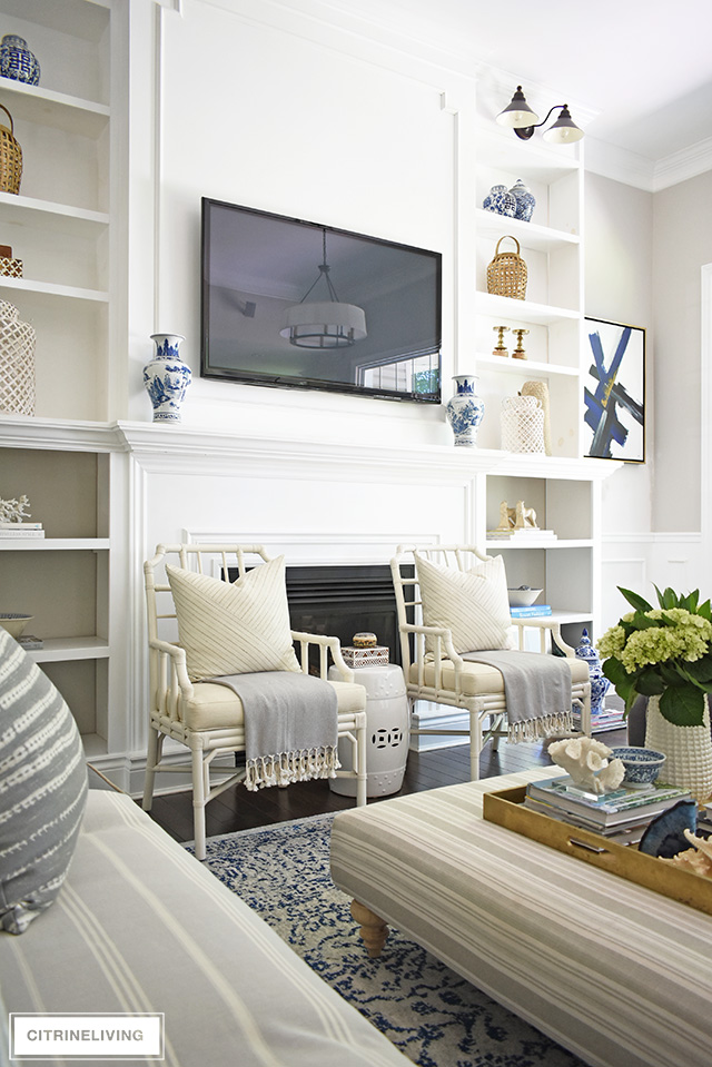 Create a casual and elegant summer living room with calming neutrals, layers of textures and hints on blue and white for a relaxing, laid-back look.
