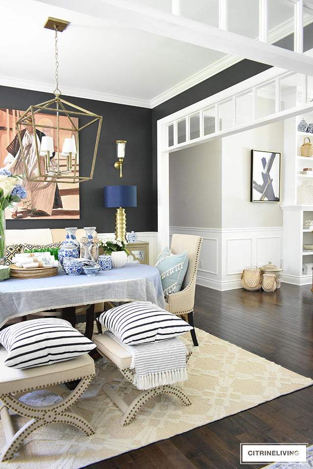 Bring a laid-back feel to your dining room with a collection of your favorite accessories, dishes and linens layered on your table for a curated look!