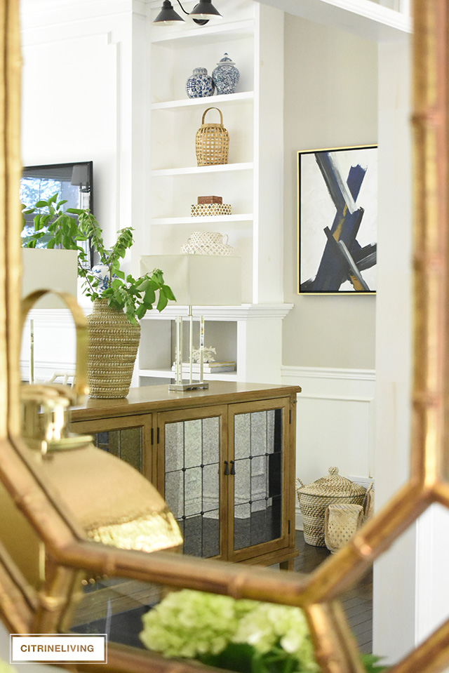Use these simple summer decorating ideas to create a casual and elegant look in your entryway this season - just a few quick changes and you'll have the perfect summer look.