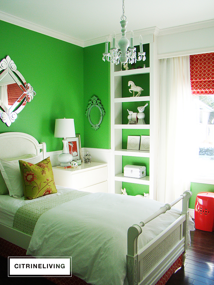 Girl's bedroom with kelly green walls, white millwork and coral accents.