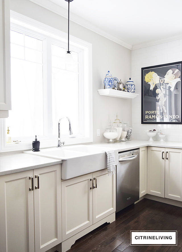 White kitchen with apron front farm sink.