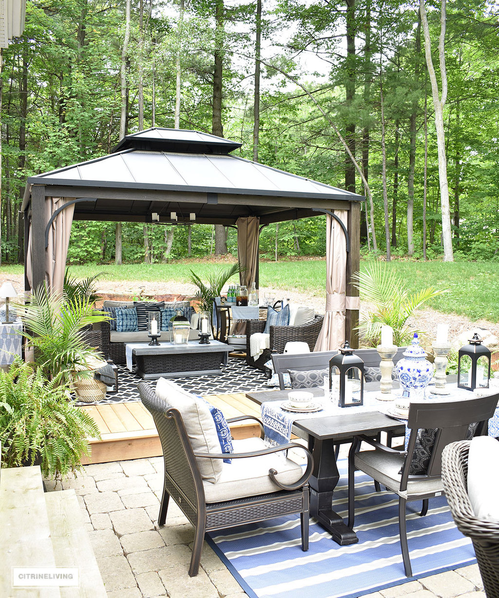 Outdoor patio makeover with large gazebo, dining area and lounge zone.