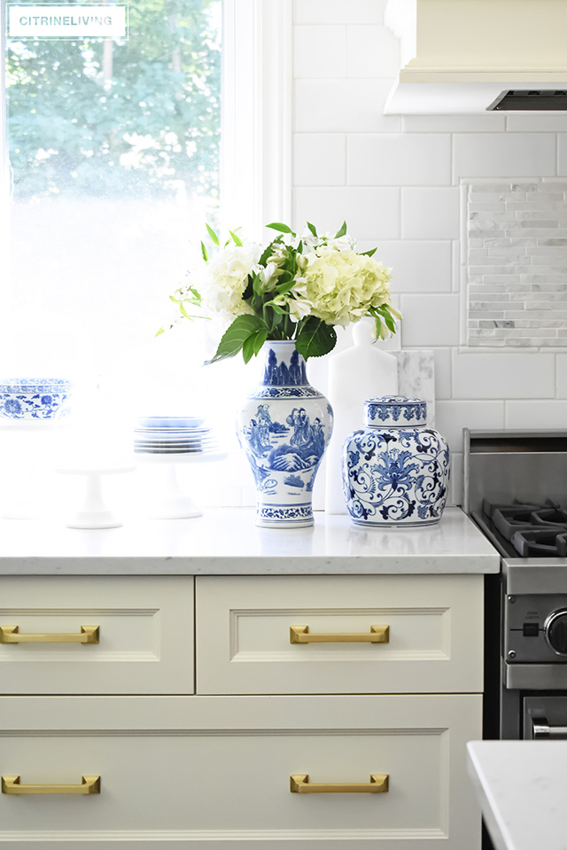 Collection of blue and white ginger jars, vases and dishes. Ivory drawers with brass hardware.
