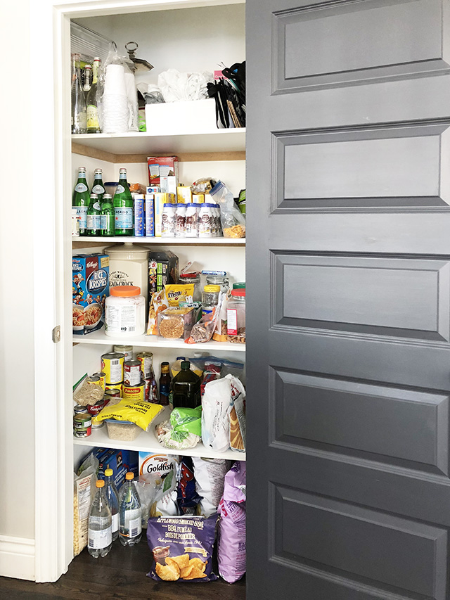 Kitchen pantry before with unorganized shelves.