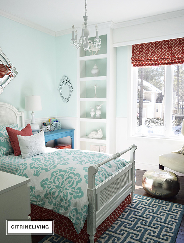 Girl's bedroom with benjamin moor refreshing teal walls and white trim.