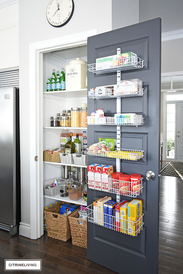 Favorite Makeovers - Kitchen pantry makeover with organized shelves, baskets, and door organizer.