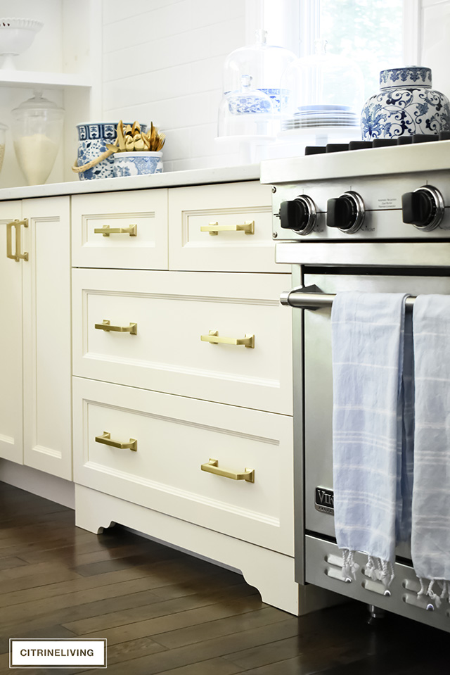 Ivory kitchen with brass hardware drawer pulls.