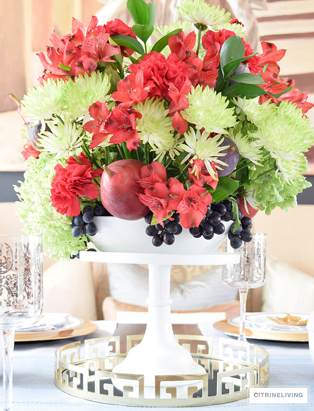 Beautiful fall centrepiece with fresh florals and fruit.
