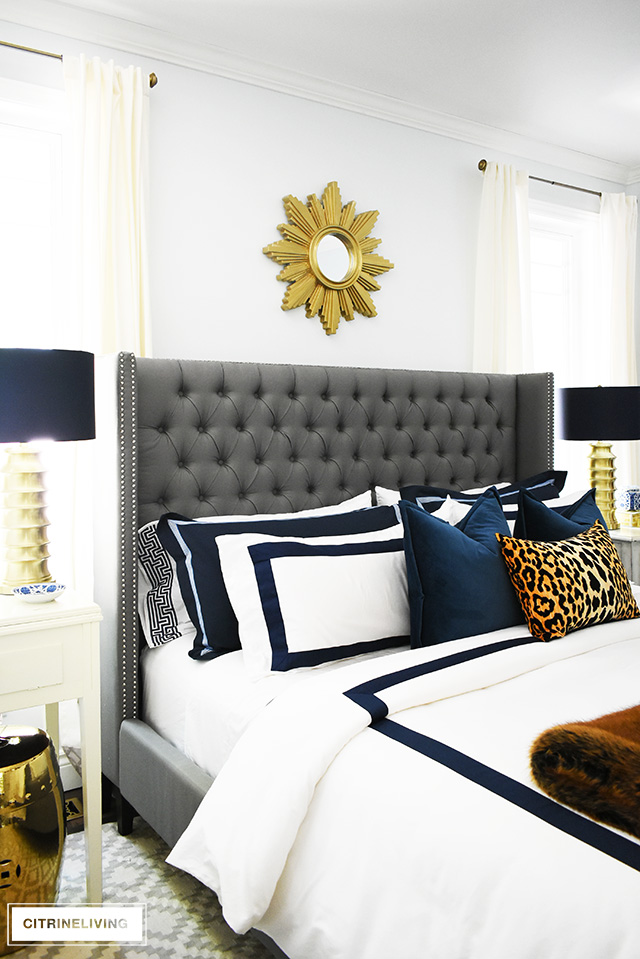 Fall bedroom decor with navy, leopard and faux fur - easy tips to transform your room for less than $20! By CitrineLiving #fallbedroomdecor #bedroom #fallbedroom #falldecor #falldecorating #falldecoratingideas #bedroomdecor #masterbedroom
